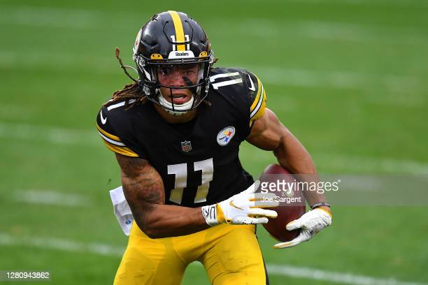 Chase Claypool of the Pittsburgh Steelers runs for a three-yard touchdown against the Cleveland Browns in the third quarter of their NFL game at...