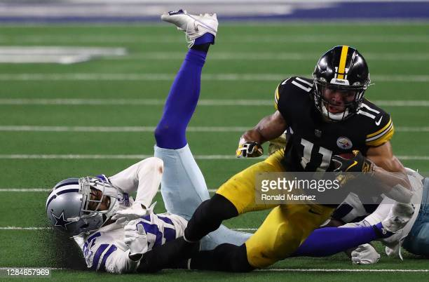 Chase Claypool of the Pittsburgh Steelers runs the ball past Trevon Diggs of the Dallas Cowboys in the fourth quarter at AT&T Stadium on November 08,...