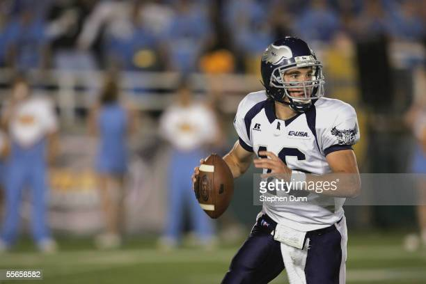 Chase Clement of the Rice Owls looks to pass the ball againts the UCLA Bruins on September 10 2005 at the Rose Bowl in Pasadena California UCLA won...