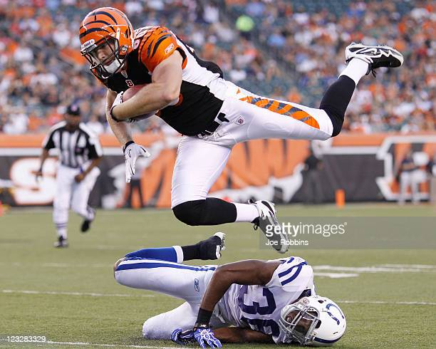 Chase Coffman of the Cincinnati Bengals jumps for a first down over Chris Rucker of the Indianapolis Colts in the first half of an NFL preseason game...