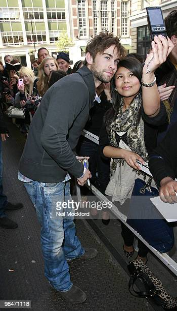Chase Crawford poses with a fan outside BBC Radio One on April 15 2010 in London England