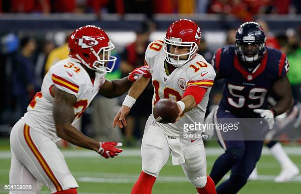 Chase Daniel hands off to Knile Davis of the Kansas City Chiefs in the second half against the Houston Texans during the AFC Wild Card Playoff game...