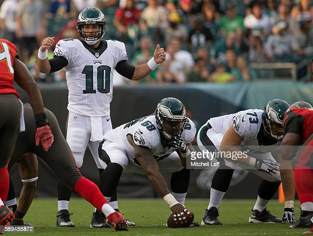 Chase Daniel Josh Andrews and Isaac Seumalo of the Philadelphia Eagles play against the Tampa Bay Buccaneers at Lincoln Financial Field on August 11...