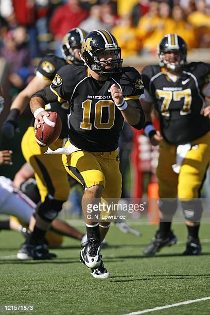 Chase Daniel of Missouri scrambles for a gain during action between the Oklahoma Sooners and the Missouri Tigers at Faurot Field in Columbia,...