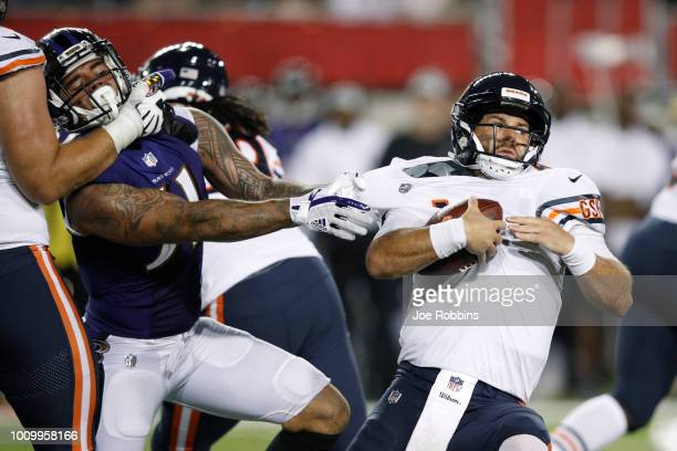 Chase Daniel of the Chicago Bears gets sacked by Kamalei Correa of the Baltimore Ravens in the second quarter of the Hall of Fame Game at Tom Benson...