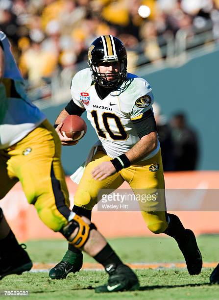 Chase Daniel of the Missouri Tigers looks for a place to run with the ball against the Arkansas Razorbacks at The Cotton Bowl on January 1, 2008 in...