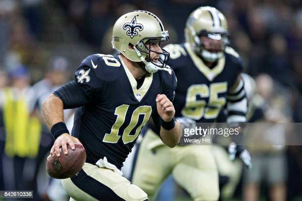 Chase Daniel of the New Orleans Saints runs with the ball during a preseason game the Baltimore Ravens at MercedesBenz Superdome on August 31 2017 in...