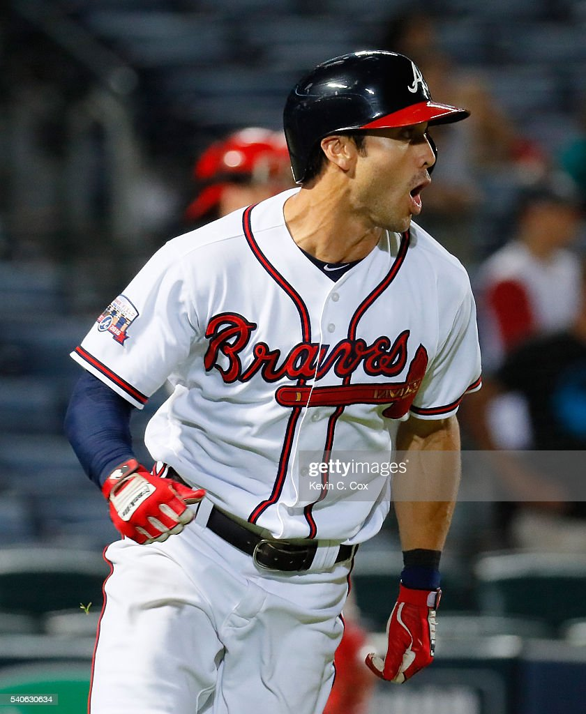 Chase d'Arnaud #23 of the Atlanta Braves hits a walk-off single in the 13th inning to give the Braves a 9-8 win over the Cincinnati Reds at Turner Field on June 15, 2016 in Atlanta, Georgia.