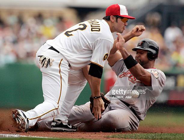 Chase D'Arnaud of the Pittsburgh Pirates attempts to tag Carlos Lee of the Houston Astros at third base on July 4 2011 at PNC Park in Pittsburgh...