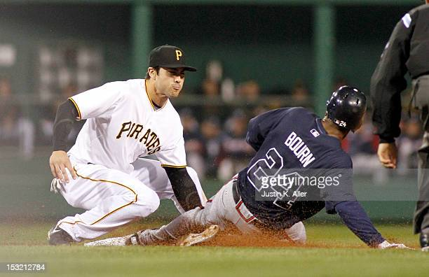 Chase d'Arnaud of the Pittsburgh Pirates tags out Michael Bourn of the Atlanta Braves during the game on October 1 2012 at PNC Park in Pittsburgh...