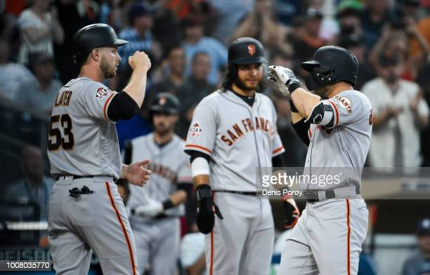 Chase d'Arnaud of the San Francisco Giants is congratulated by Austin Slater and Brandon Crawford after hitting a threerun home run during the second...