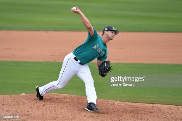 Chase De Jong of the Seattle Mariners delivers a pitch in the fifth inning of the spring training game against the Oakland Athletics at Peoria...