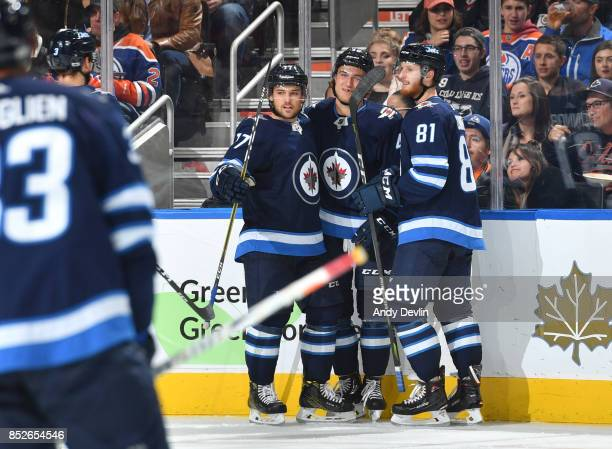 Chase De Leo Brendan Lemieux and Kyle Connor of the Winnipeg Jets celebrate after a goal during the preseason game against the Edmonton Oilers on...