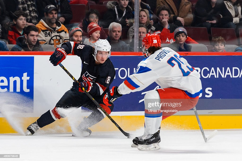 Chase De Leo #18 of Team United States puts on the breaks in front of Ivan Provorov #29 of Team Russia in a quarterfinal round during the 2015 IIHF World Junior Hockey Championships at the Bell Centre on January 2, 2015 in Montreal, Quebec, Canada.