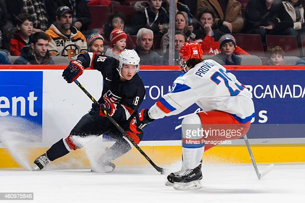 Chase De Leo of Team United States puts on the breaks in front of Ivan Provorov of Team Russia in a quarterfinal round during the 2015 IIHF World...