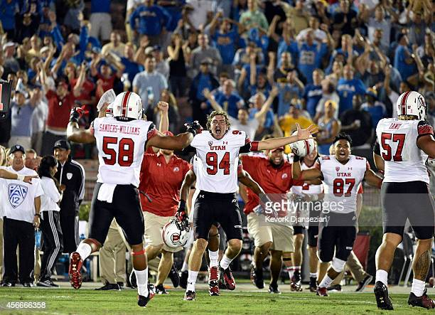 Chase Dominguez of the Utah Utes and fellow teammates celebrate their upset win over UCLA Bruins at the Rose Bowl October 04 in Pasadena, California.