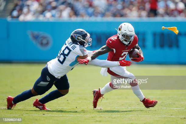 Chase Edmonds of the Arizona Cardinals runs past Harold Landry of the Tennessee Titans during the first quarter at Nissan Stadium on September 12,...