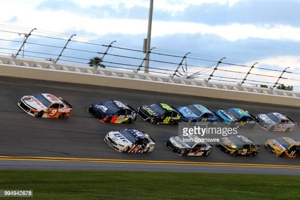 Chase Elliot driver of the Hooters Chevy leads the pack through turn 3 during the Coke Zero 400 Monster Energy Cup Series race on July 7 at Daytona...