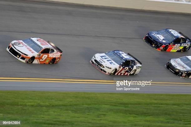 Chase Elliot leads Brad Keselowski through turn 3 during the start of the Coke Zero 400 Monster Energy Cup Series race on July 7 at Daytona...