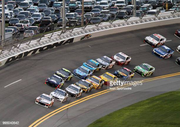 Chase Elliot leads the field through turn 4 during the NASCAR Monster Energy Cup Series Coke Zero 400 in July 07 2018 at Daytona International...