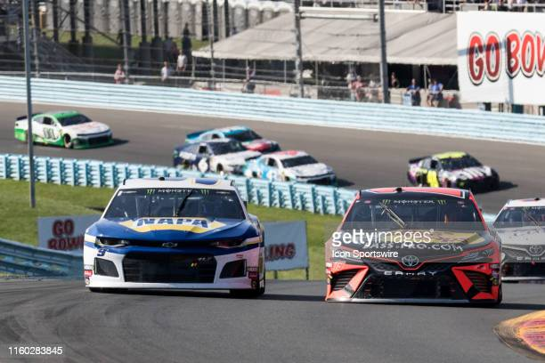 Chase Elliott and Martin Truex Jr race door to door up the esses during the Monster Energy NASCAR Cup Series, GoBowling at The Glen on August 04 at...