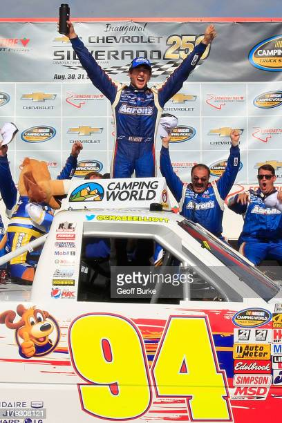 Chase Elliott driver of the Aaron's Dream Machine/Hendrickcarscom Chevrolet celebrates in victory lane after winning the NASCAR Camping World Truck...