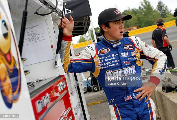 Chase Elliott driver of the Aaron's/HendrickCarscom Chevrolet looks on during the NASCAR KN Pro Series East Samuel 150 on July 14 2012 at CNB Bank...