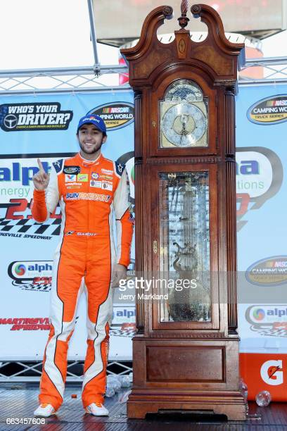 Chase Elliott driver of the Allegiant Airlines/NAPA Chevrolet celebrates in Victory Lane after winning the NASCAR Camping World Truck Series Alpha...