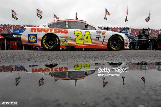 Chase Elliott driver of the Hooters Chevrolet drives through the garage area during practice for the Monster Energy NASCAR Cup Series GEICO 500 at...