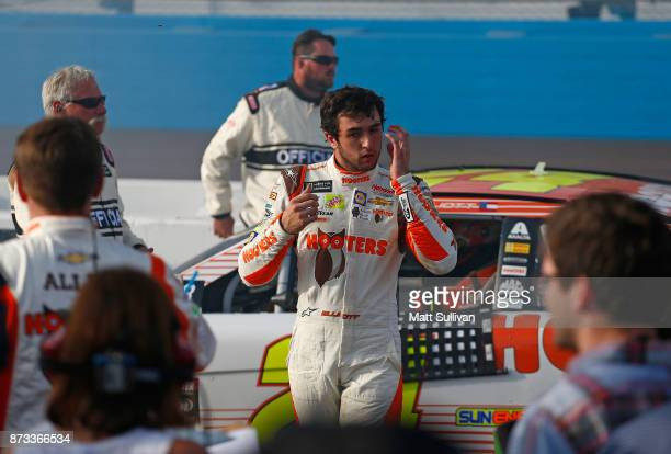 Chase Elliott driver of the Hooters Chevrolet exits his car after finishsing the Monster Energy NASCAR Cup Series CanAm 500 at Phoenix International...