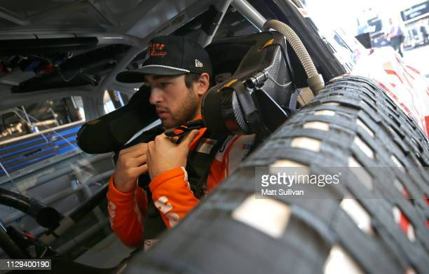 Chase Elliott, driver of the Hooters Chevrolet, gets into his car during practice for the Monster Energy NASCAR Cup Series TicketGuardian 500 at ISM...