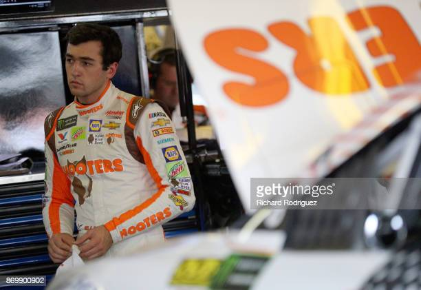 Chase Elliott driver of the Hooters Chevrolet looks on during practice for the Monster Energy NASCAR Cup Series AAA Texas 500 at Texas Motor Speedway...