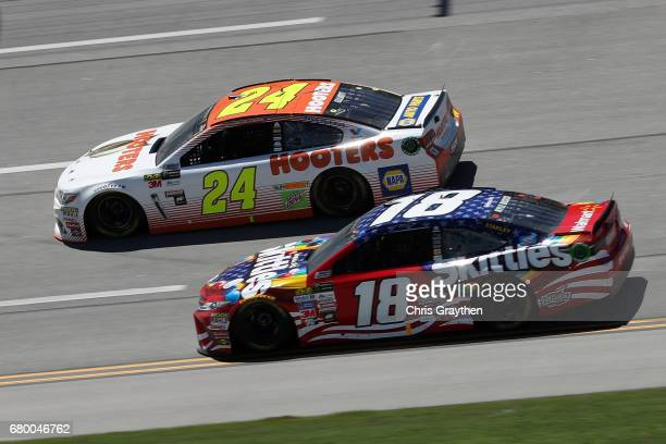 Chase Elliott driver of the Hooters Chevrolet races Kyle Busch driver of the Skittles Red White Blue Toyota during the Monster Energy NASCAR Cup...