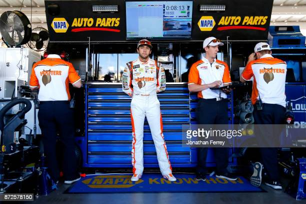 Chase Elliott driver of the Hooters Chevrolet stands in the garage area during practice for the Monster Engergy NASCAR Cup Series CanAm 500 at...