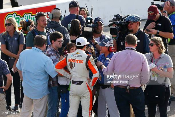 Chase Elliott driver of the Hooters Chevrolet talks to the media after the Monster Energy NASCAR Cup Series CanAm 500 at Phoenix International...
