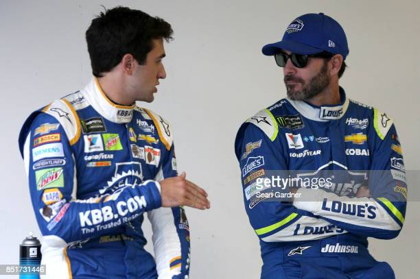 Chase Elliott driver of the Kelley Blue Book Chevrolet and Jimmie Johnson driver of the Lowe's Chevrolet talk during qualifying for the Monster...