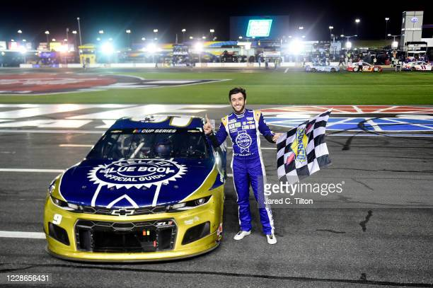 Chase Elliott driver of the Kelley Blue Book Chevrolet celebrates after winning the NASCAR Cup Series Alsco Uniforms 500 at Charlotte Motor Speedway...