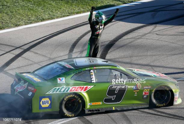 Chase Elliott driver of the Mountain Dew Chevrolet celebrates after winning the Monster Energy NASCAR Cup Series Hollywood Casino 400 at Kansas...