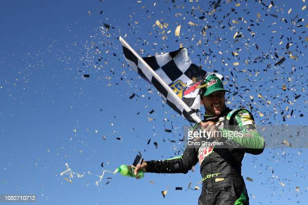 Chase Elliott driver of the Mountain Dew Chevrolet celebrates in victory lane after winning the Monster Energy NASCAR Cup Series Hollywood Casino 400...
