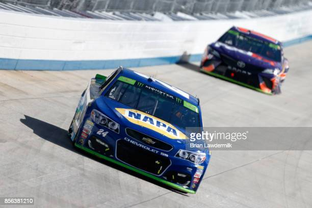 Chase Elliott driver of the Mountain Dew Chevrolet leads Denny Hamlin driver of the FedEx Freight Toyota during the Monster Energy NASCAR Cup Series...
