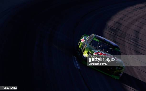 Chase Elliott driver of the Mountain Dew Chevrolet races during the Monster Energy NASCAR Cup Series Hollywood Casino 400 at Kansas Speedway on...
