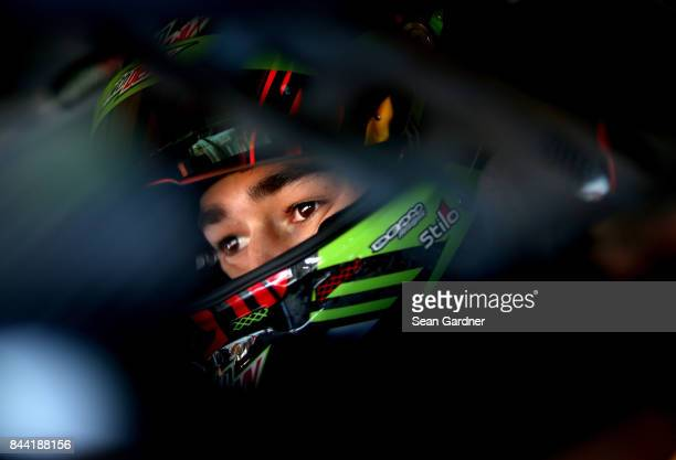 Chase Elliott driver of the Mountain Dew Chevrolet sits in his car during ractice for the Monster Energy NASCAR Cup Series Federated Auto Parts 400...