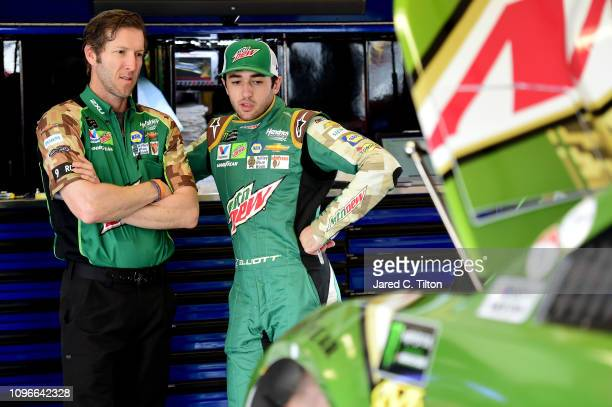 Chase Elliott driver of the Mountain Dew Chevrolet speaks with his crew chief Alan Gustafson in the garage area during practice for the Monster...