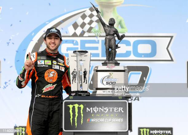 Chase Elliott driver of the Mountain Dew/Little Caesar's Chevrolet celebrates in victory lane after winnin the Monster Energy NASCAR Cup Series GEICO...