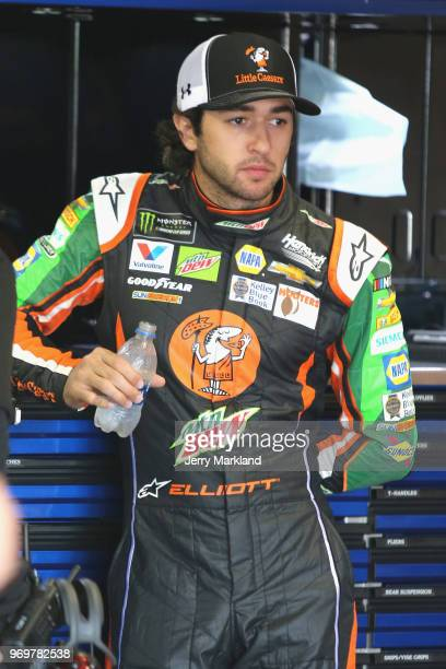 Chase Elliott driver of the Mountain Dew/Little Caesars Chevrolet stands in the garage area during practice for the Monster Energy NASCAR Cup Series...