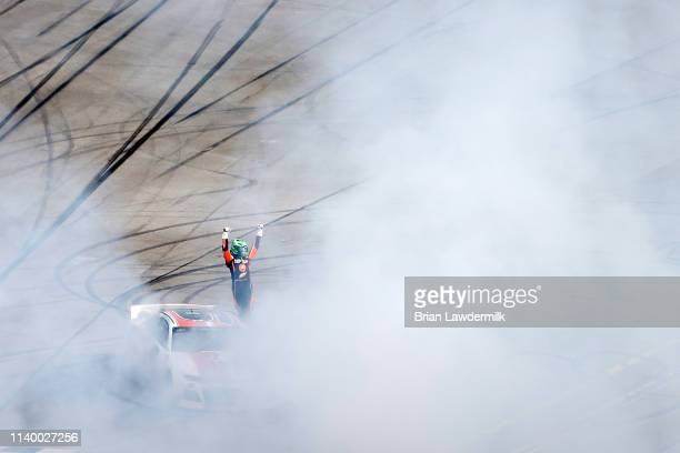 Chase Elliott driver of the Mountain Dew/Little Caesar's Chevrolet celebrates winning the Monster Energy NASCAR Cup Series GEICO 500 at Talladega...
