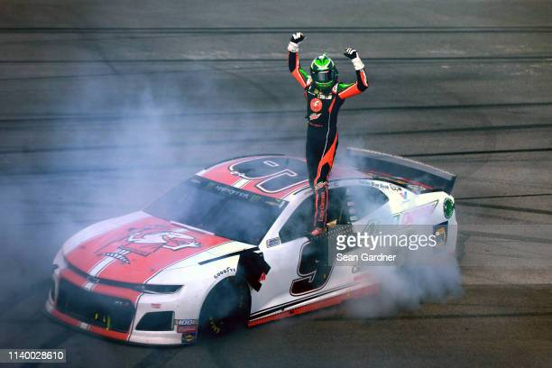 Chase Elliott driver of the Mountain Dew/Little Caesar's Chevrolet celebrates after winning the Monster Energy NASCAR Cup Series GEICO 500 at...