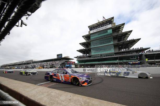 Chase Elliott, driver of the NAPA Auto Parts Cahevrolet, and Denny Hamlin, driver of the FedEx Possibilities Toyota, race during the Monster Energy...