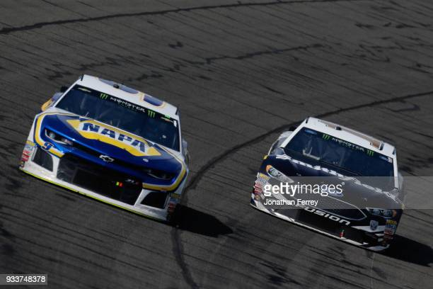 Chase Elliott driver of the NAPA Auto Parts Chevrolet and Aric Almirola driver of the Smithfield Ford race during the Monster Energy NASCAR Cup...
