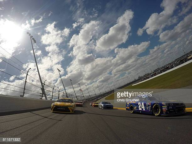 Chase Elliott driver of the NAPA Auto Parts Chevrolet and Kyle Busch driver of the MM's 75 Toyota lead the field during the pace laps prior to the...